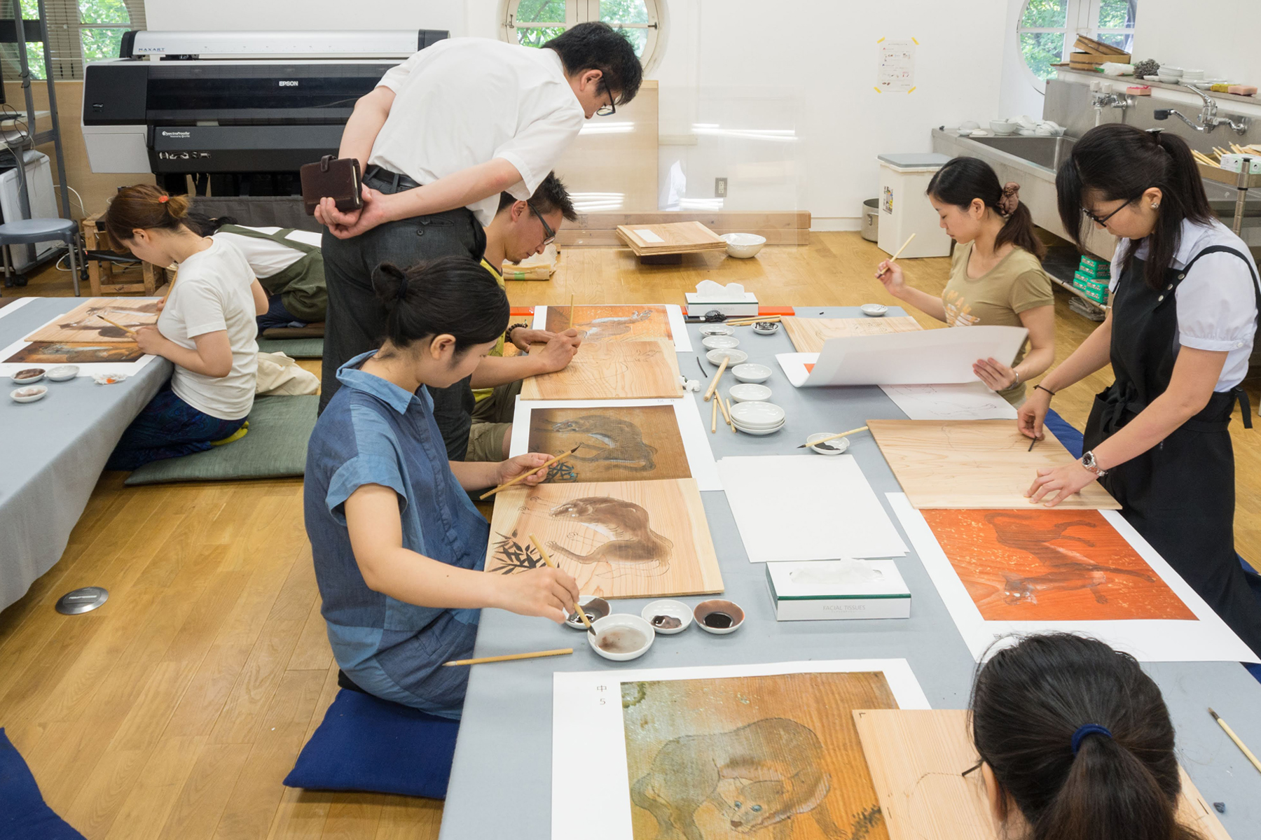 Under the supervision of professor Kei Arai, students at the Tokyo University of the Arts reproduce 242 ceiling paintings of wolves at Yamatsumi Shrine in Fukushima Prefecture that have been destroyed by fire.   MICHIKO HAYASHI